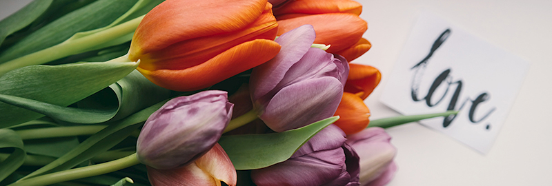 Colorful flowers with a printed love note