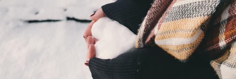 Snow heart being held in hands