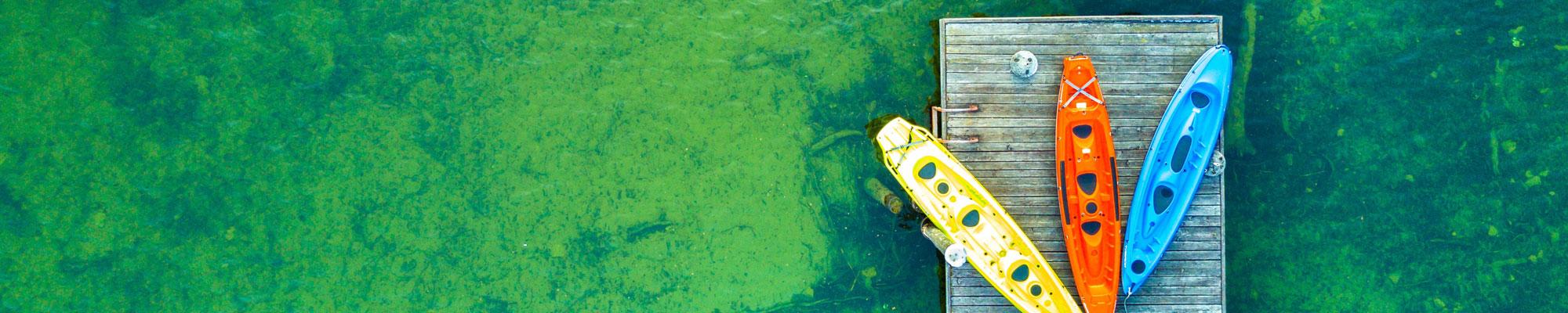 Photograph of Kayaks Waiting on Dock