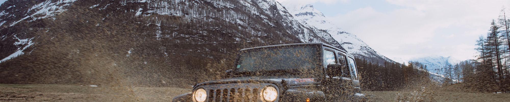 Photograph of car driving through mountains